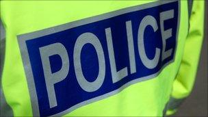 police sign on jacket