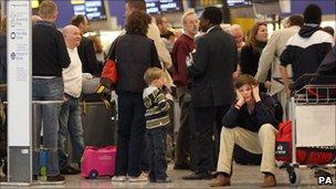 Passengers at a busy airport