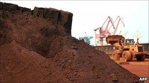 Mountain of soil containing rare earth materials ready to be exported from China to Japan