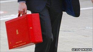Minister carrying red box
