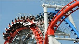 """Photo taken on March 18, 2010 shows visitors riding on the """"Battlestar Galactica roller-coaster"""" at Universal Studios Singapore theme park during its opening day in Singapore"""