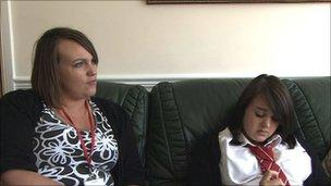 Hannah Dudley and Loretta share the family sofa