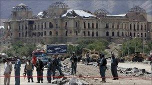 Kabul police at scene of bomb blast near palace destroyed during civil war in 1990s (file photo: May 2010)