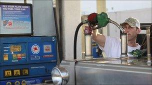 Driver filling up his truck with petrol at a Mobil filling station in Los Angeles