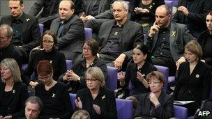 Green MPs attend the vote in the German parliament, 28 October