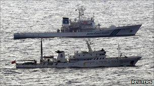 A Japanese coast guard vessel (top) and a Chinese fisheries patrol vessel near near the disputed islands in the East China Sea, known as the Senkaku isles in Japan, Diaoyu in China - 28 September 2010