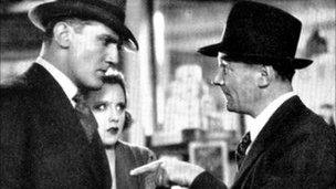 Photograph of actors John Longden, Anny Ondra and Donald Calthrop in Blackmail.