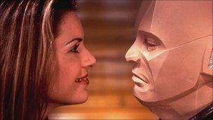 Chloe Annet as Kochanski and Robert Llewellyn as Kryten in Red Dwarf (1999)