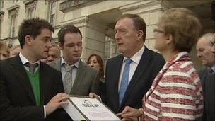 Pat Ramsey and students holding petition