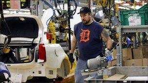 Worker on the Cadillac production line at the General Motors plant in Lansing, Michegan