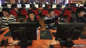 Computer users in an internet cafe