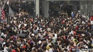 People queue for the launch of the iPhone