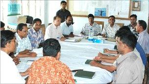 Grameen workers sitting round a table