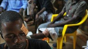 A man that was injured to the head during altercations between supporters of Cellou Dalein Diallo and Alpha Conde after a campaign rally in Conakry