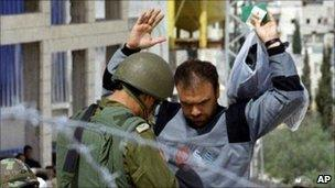 Palestinian searched by Israeli soldier (file)
