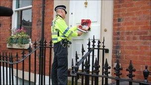 Police leafletting residents during the drugs raids
