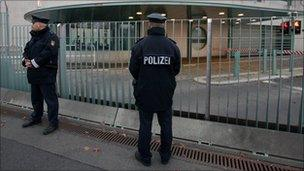 """German police guard the main gate of the Chancellery in Berlin after the """"suspicious package"""" was found - 2 November 2010"""