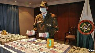 Packets of cash seized by police in Bogota on 5 October, 2010