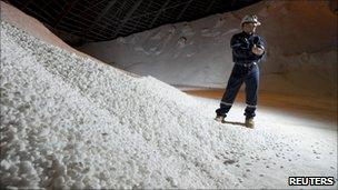 A Potash Corporation worker holding a handful of potash