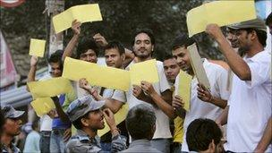 Youths belonging to a self proclaimed non-political group hold up yellow cards at Constituent Assembly members, outside the Parliament House in Kathmandu, September 26, 2010, saying they should be penalized for a foul for not being able to elect a new Prime Minister.