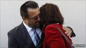 Helmand Governor Gulabuddin Mangal embraces Lucy Aldridge whose son died in Afghanistan