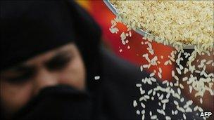 A woman receives subsidised rice in Bangladesh
