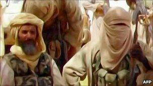 Video grab taken from Al Andalus TV by AFP shows al-Qaeda in the Islamic Maghreb militants - released 30 September 2010