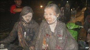 Villagers flee their home following another eruption Mount Merapi