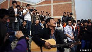 Demonstrators outside Ai Weiwei's Shanghai studio