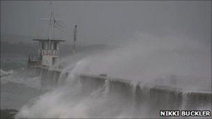 Waves top the breakwater at Mountbatten in Plymouth