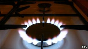 A lit gas ring on a cooker