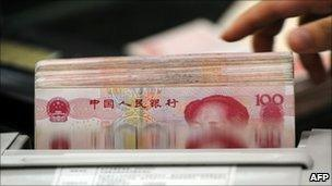 Clerk counting 100-yuan notes