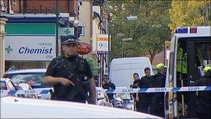 Armed police at Beech Avenue