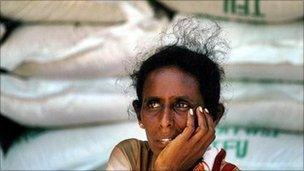 Sri Lanka woman behind rice stockpile