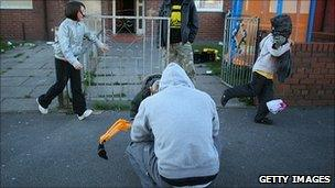 Family outside council estate in Salford
