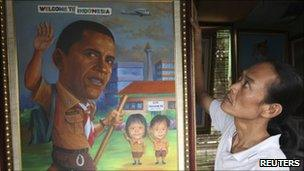 A street artist in a Jakarta store displays a picture welcoming Mr Obama