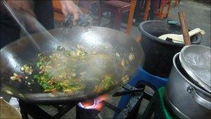 Deri was busy cooking nasi goreng at the Jalan Sabang hawker centre
