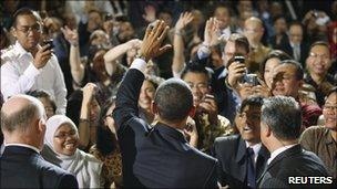 US President Barack Obama greets members of the audience after delivering a speech at the University of Indonesia