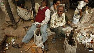Indian carpenters waiting for work