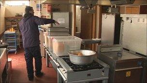 Pre-cooked meals being delivered to school kitchen