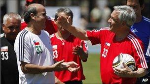 President Sebastian Pinera (right) jokes with freed miner Franklin Lobos after a football game on 25 October