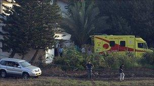 The ambulance carrying Mr Sharon, arrives at his ranch in southern Israel