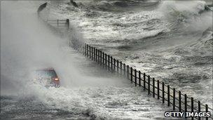 A car is engulfed by water in Saltcoats, North Ayrshire, on 11 November 2010.