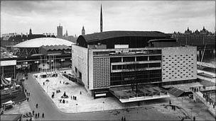 The Royal Festival Hall at the time of the 1951 Festival of Britain with the Dome of Discovery and the Skylon