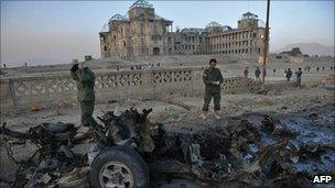 Destroyed car in front of the Afghan former royal palace, Kabul (12 Nov 2010)