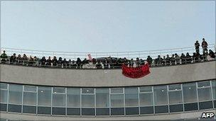 Protesters on the roof at 30 Millbank