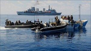 Officers from RFA Fort Victoria boarding a ship