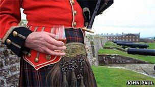 Piper at Fort George holding a glass of the single malt. Image: John Paul