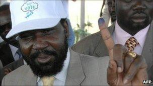 South Sudan President Salva Kiir showing his ink-stained finger after registering