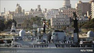 Sailors stand on the deck of British Navy HMS Manchester Type 42 Destroyer as it enters Havana's Harbour